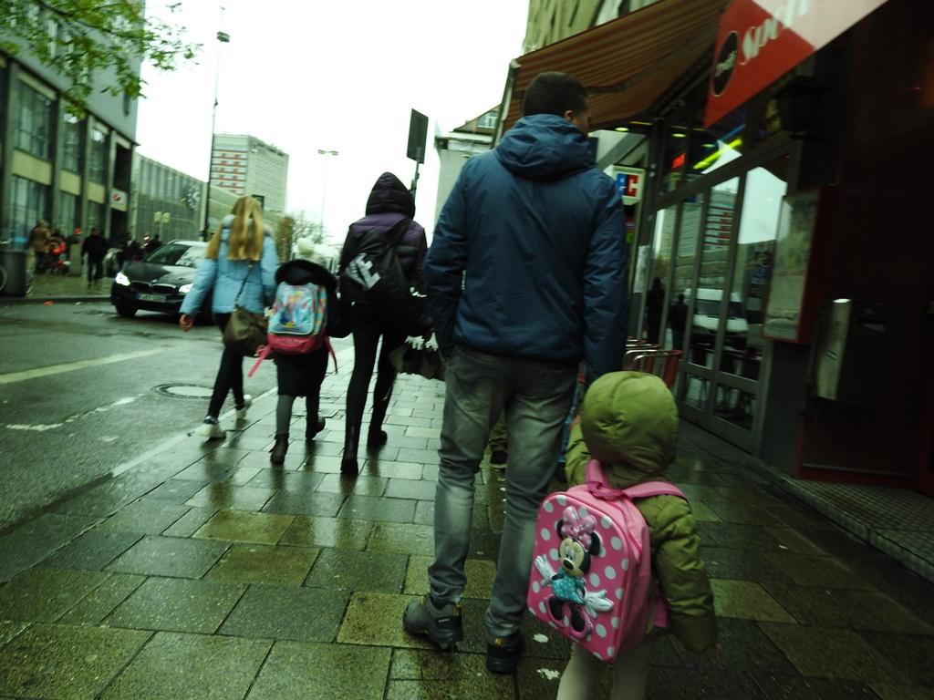 Lara and dad in rainy Munich