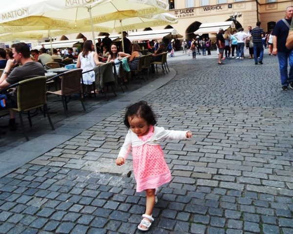 Lara strolling on the old town square