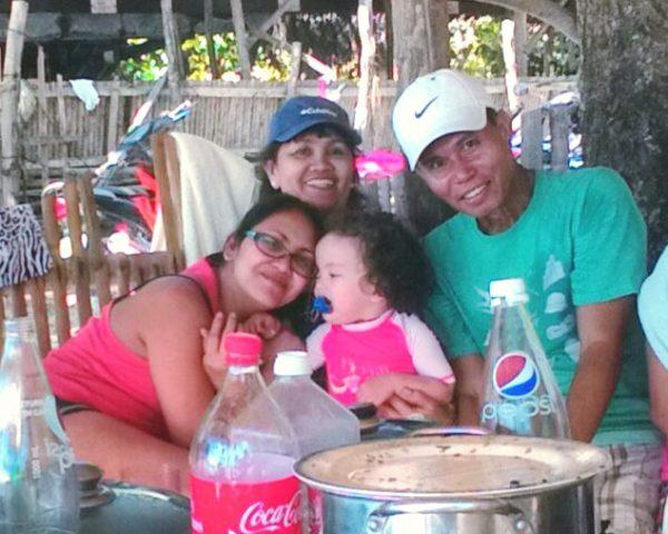 Lara with mom, lola and lolo at Lara Beach Bohol
