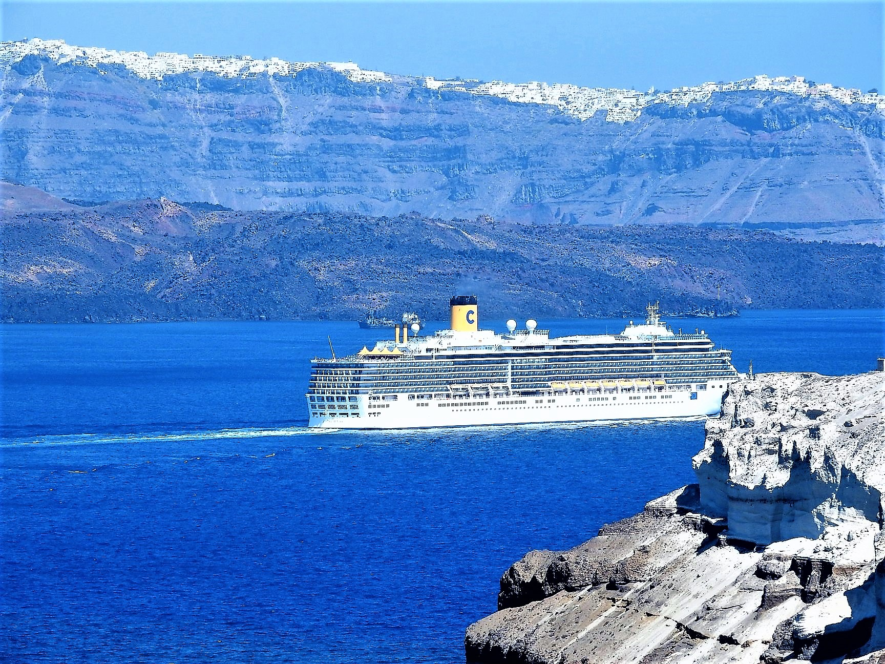 Cruise ship crossing the sea in Santorini