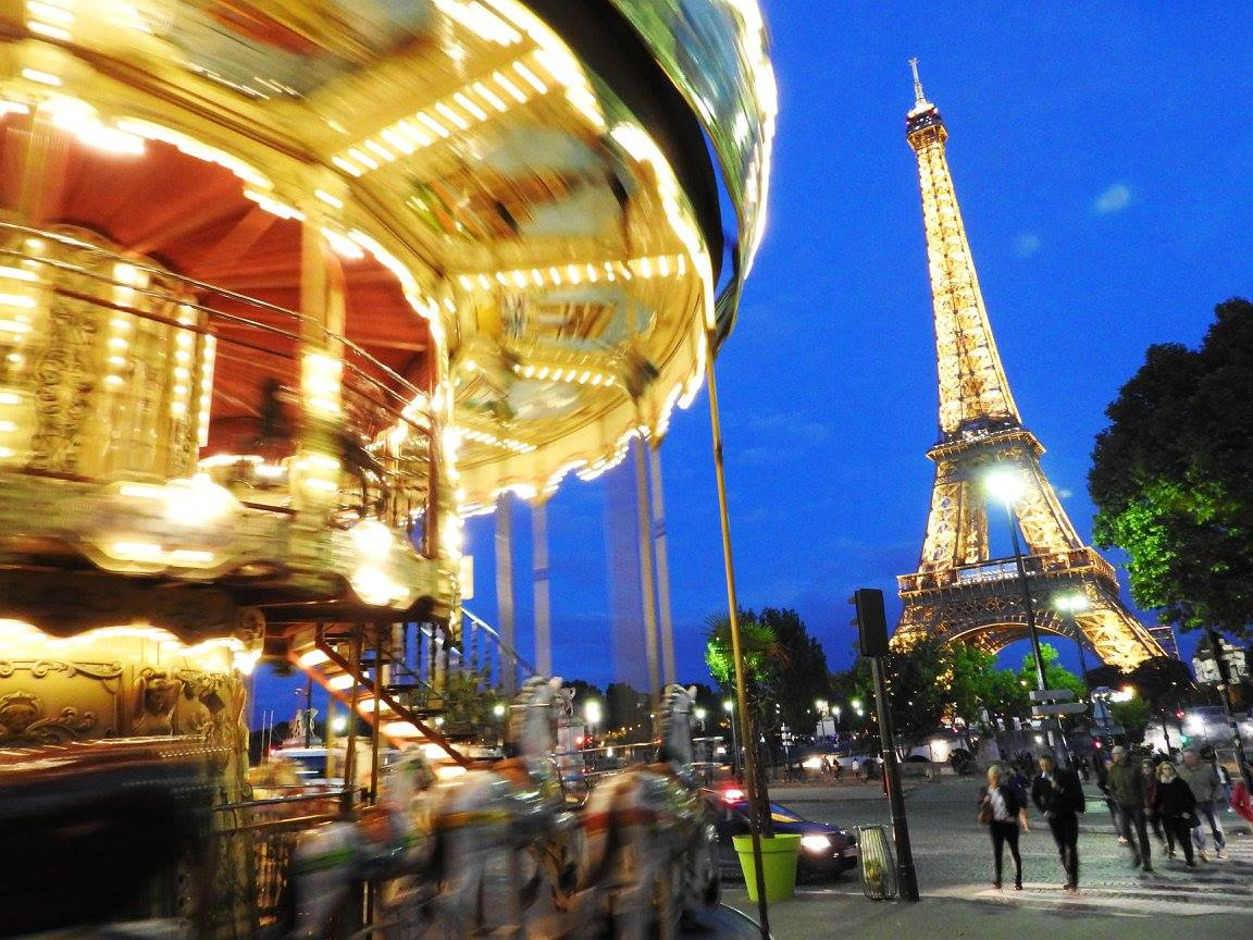 Eiffel Tower by night at the carousel