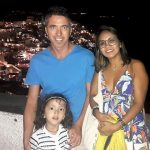 Family photo in Santorini by night. Lara is the world's youngest travel blogger.
