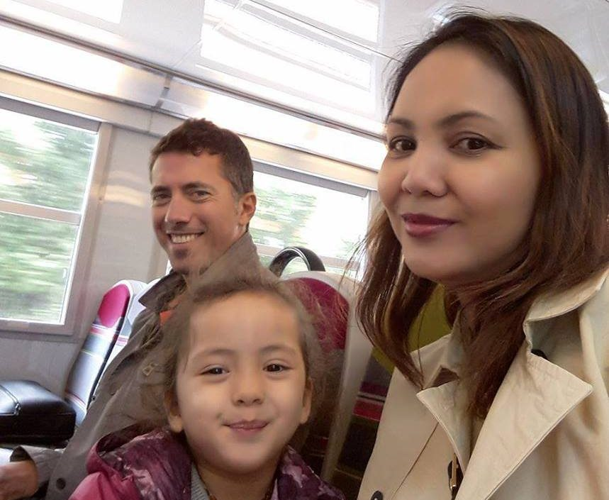 Lara, Mom, and Dad on the train to Paris