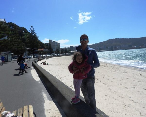 Lara and Dad at the beach in Wellington
