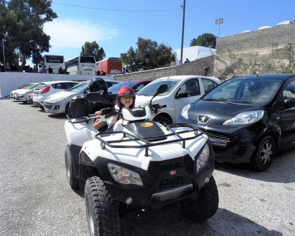 Lara and her quad in Santorini