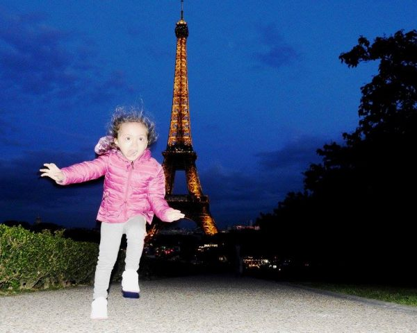 Lara and the Eiffel Tower by night