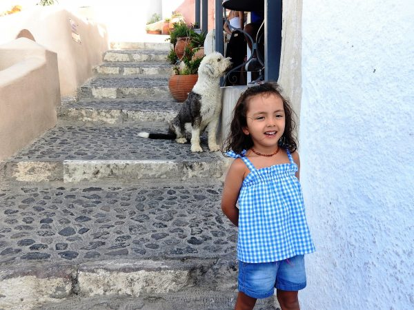 Lara in Oia, Santorini. Lara is the youngest travel blogger. in the world