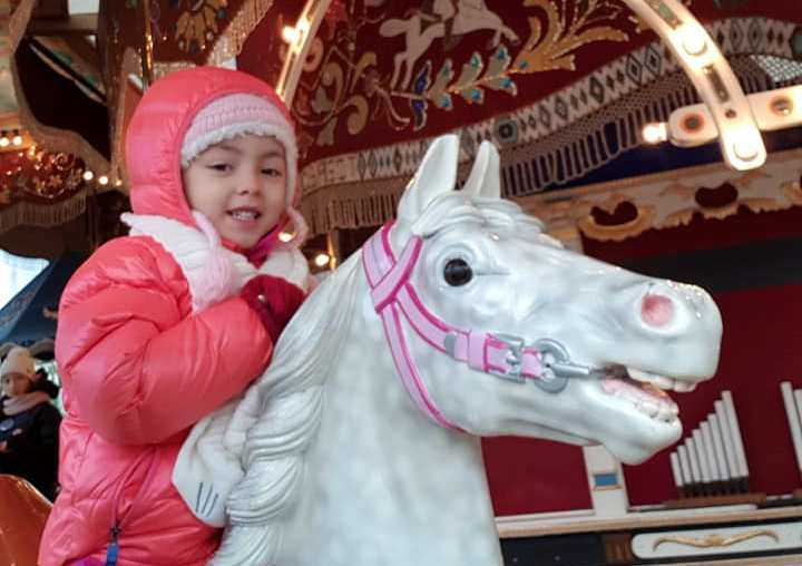 Lara having a great time at the carousel of the Christmas Market of Helsinki Finland